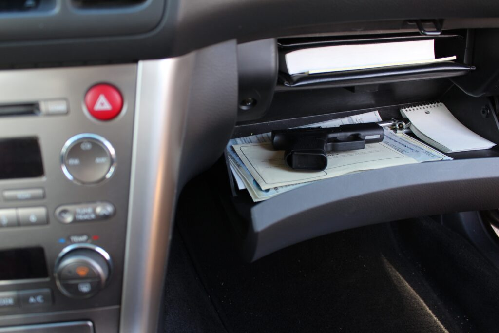 gun in glovebox car compartment